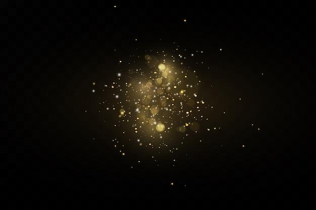Effet scintillant des particules. l'or scintille. particules scintillantes de poussière d'étoile sur un fond transparent.