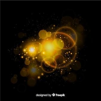 Effet spatial de particules flottantes dorées