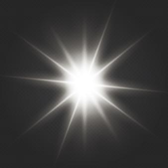 Effet spécial light flare avec des rayons de lumière et des étincelles magiques. lumière lueur