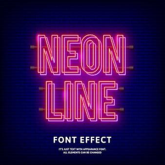 Effet de texte néon lumineux sur le mur de briques