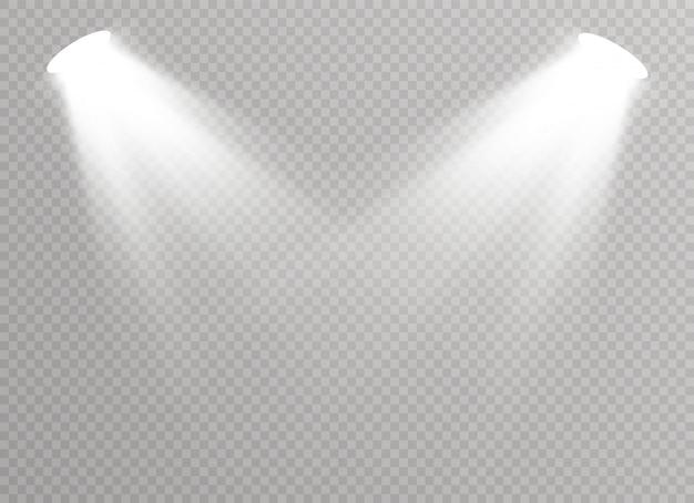 Effets de lumières isolés sur fond transparent. rayons et projecteurs. effet de lumière luminescente.