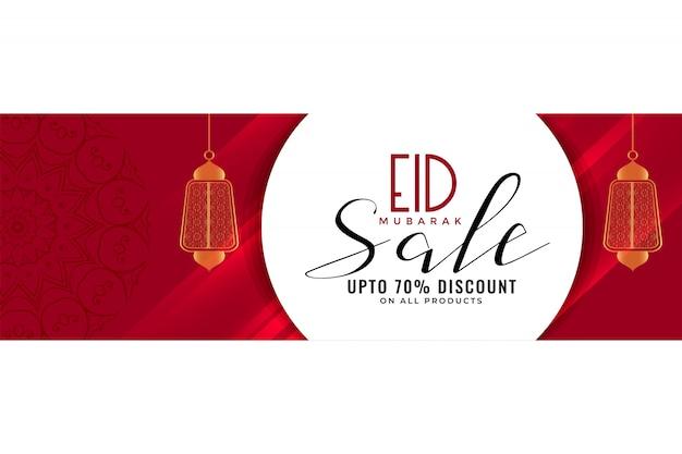 Eid vente bannière ou en-tête avec des lanternes suspendues