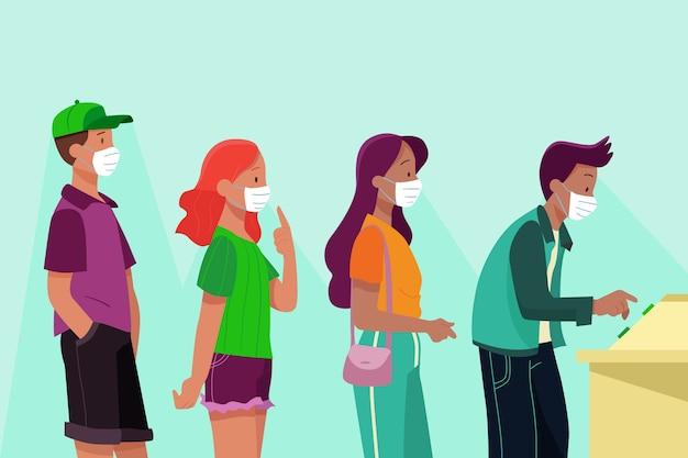 Les électeurs attendent en ligne avec des masques médicaux