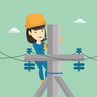 Électricien travaillant sur poteau électrique.