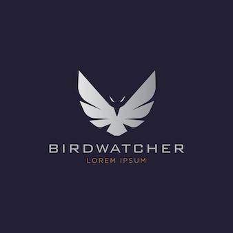 Elégant logo de silhouette d'aigle volant