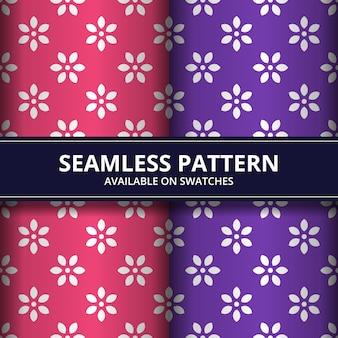 Élégant papier peint de fond sans couture de fleurs géométriques batik en couleur rose et violet