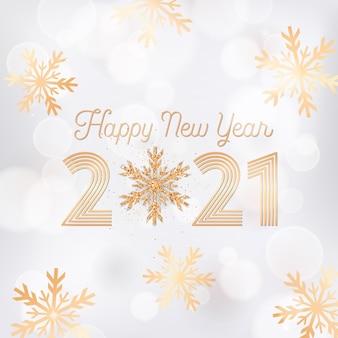 Élégante carte postale de voeux de nouvel an, dépliant d'invitation ou conception de brochure promotionnelle, carte de bonne année avec des flocons de neige dorés et des paillettes sur fond blanc flou avec affiche de typographie dorée 2021