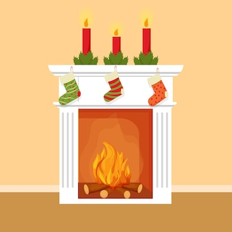 Élément décoratif de cheminée de noël avec des chaussettes pour des bougies de cadeaux