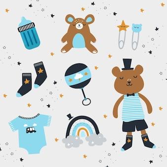 Éléments de bébé garçon avec des jouets et des vêtements mignons