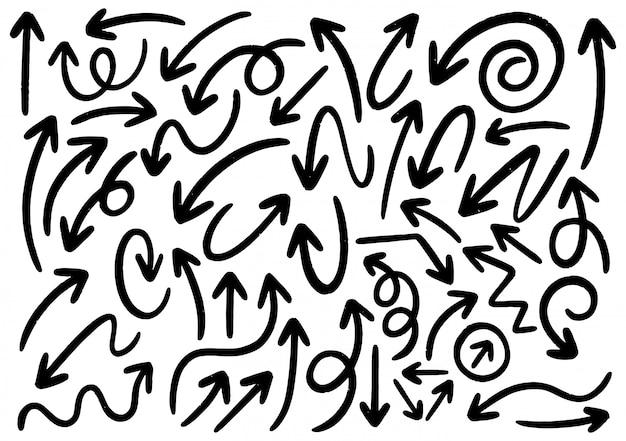 Éléments de conception de doodle dessinés à la main. flèches, cadres, bordures, icônes et symboles dessinés à la main.