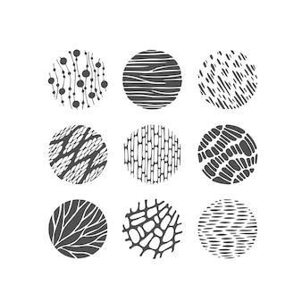 Éléments graphiques texturés noirs, cercles de motifs, décorations monochromes rondes.