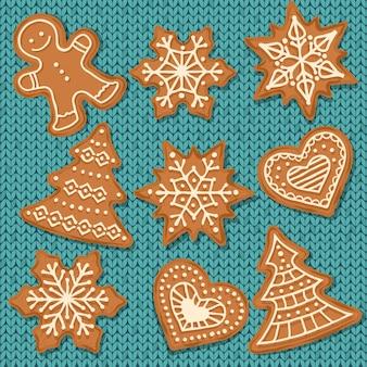 Éléments de pain d'épice mignons isolés sur fond tricoté
