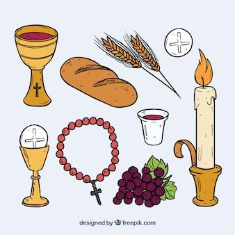 Les éléments traditionnels de la première communion dessinés à la main