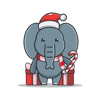 Éléphant mignon avec boîte-cadeau tenant des bonbons de noël