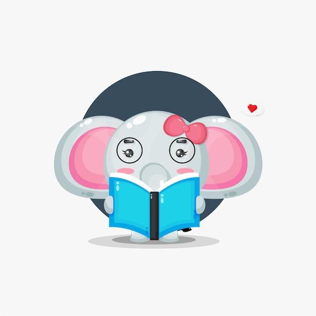 L'éléphant mignon lit un livre