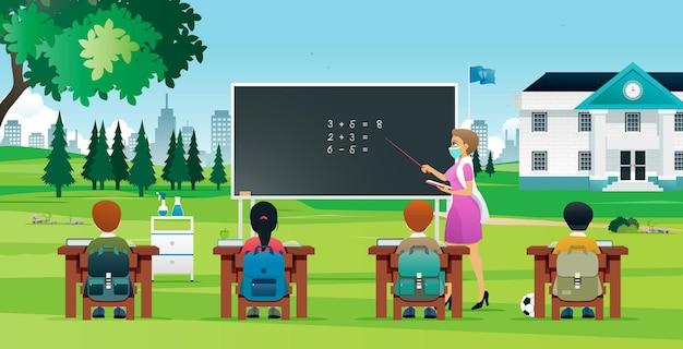 Les élèves en dehors de la salle de classe apprennent à empêcher la propagation de covid19