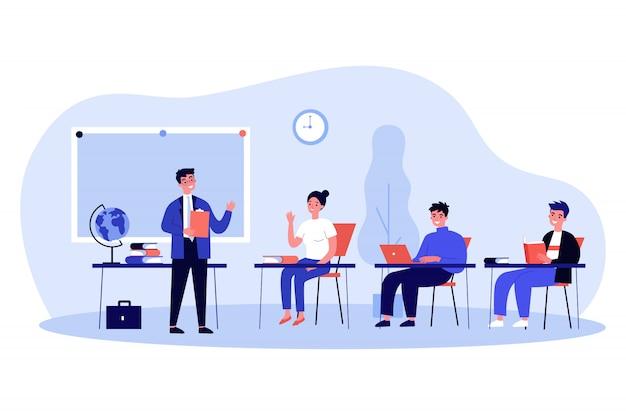 Élèves heureux assis au bureau en classe
