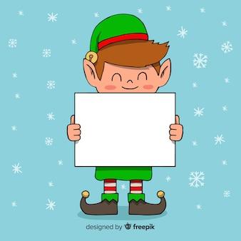 Elfe dessin animé tenant une pancarte blanche