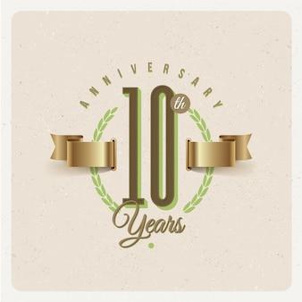 Emblème d'anniversaire de 10 ans vintage avec ruban d'or et couronne de laurier - illustration