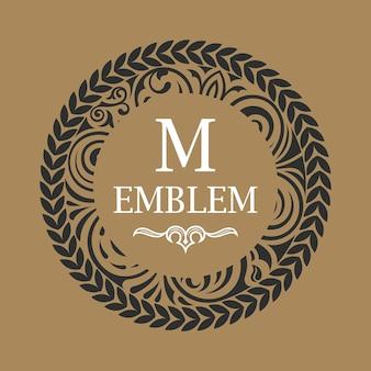 Emblème floral calligraphique m