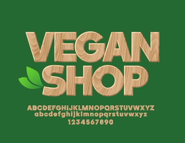 Emblème avec texte vegan shop polices texturées en bois bio tree pattern alphabet letters and numbers