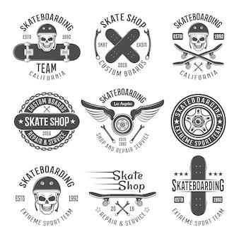 Emblèmes noirs de skateboard