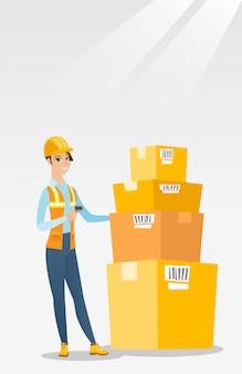 Employé d'entrepôt numérisation code à barres sur la boîte.