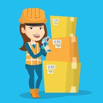 Employé d'entrepôt scannant le code-barres sur la boîte.