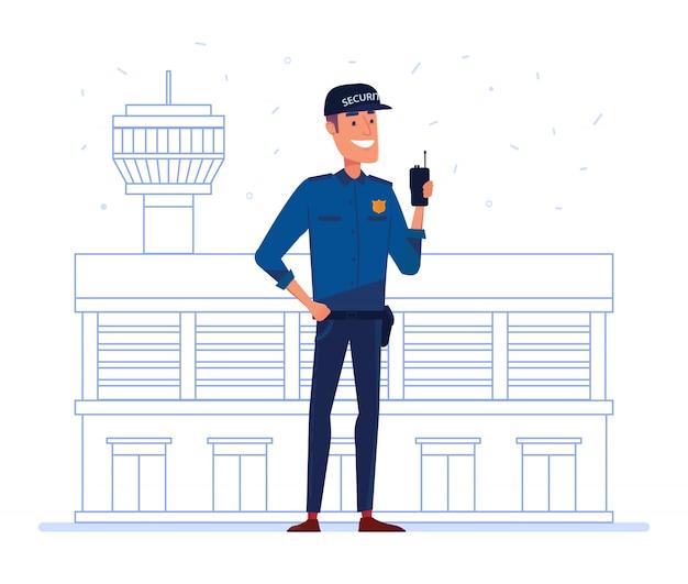 Employé d'une entreprise de sécurité avec radio portable devant le bâtiment de l'aéroport.