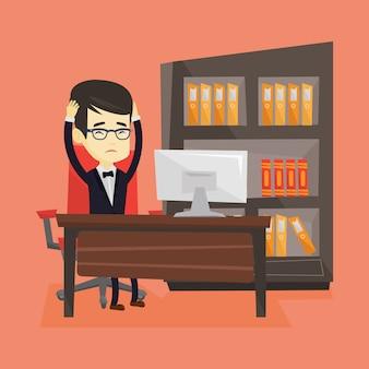 Employé stressé travaillant au bureau.