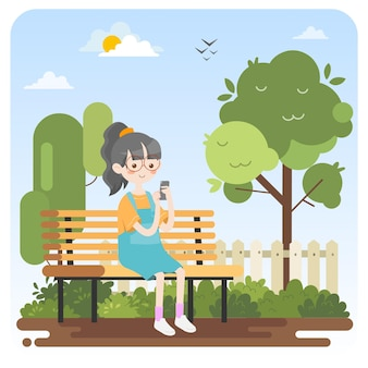 Enfant à l'aide de handphone au parc
