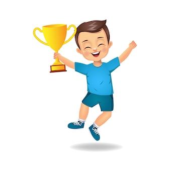 Enfant garçon heureux avec coupe du trophée