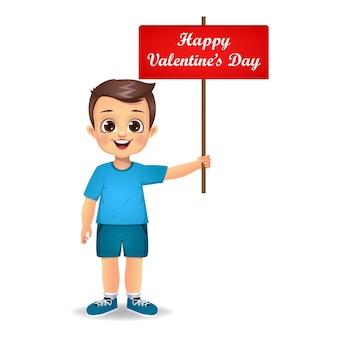 Enfant garçon mignon tenant la bannière de la saint-valentin heureuse