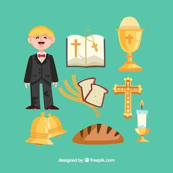 Enfant heureux avec les éléments de la première communion