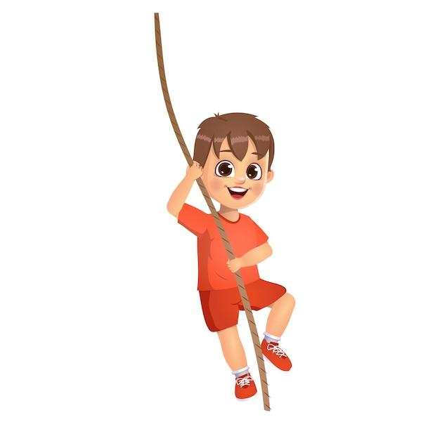Enfant mignon de garçon s'élevant sur la corde