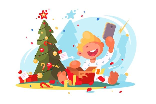 L'enfant ouvre le cadeau de noël. smartphone dans une boîte cadeau.