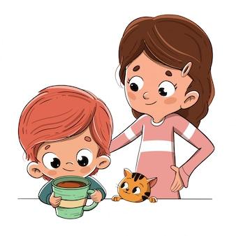 Enfant prenant son petit-déjeuner ou une collation en famille