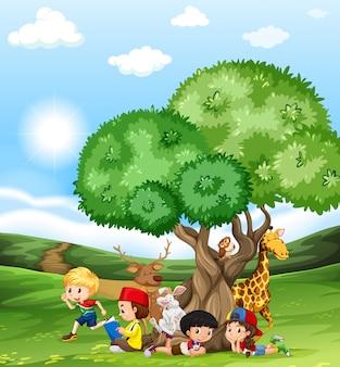 Enfants et animaux sauvages dans le champ