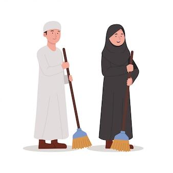 Enfants arabes transportant un balai pour nettoyer l'illustration de dessin animé