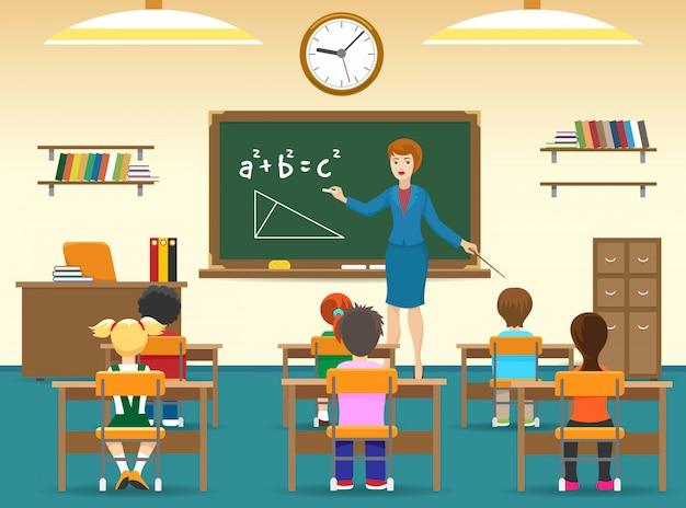 Enfants assis dans la salle de classe