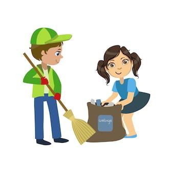 Enfants avec balai et sac poubelle