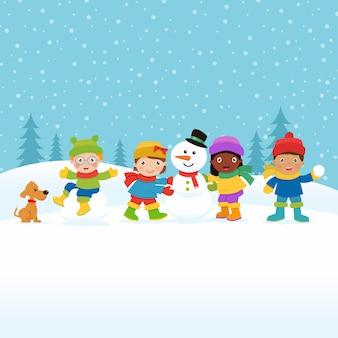Enfants construisant un bonhomme de neige