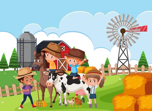 Enfants dans la scène de la ferme