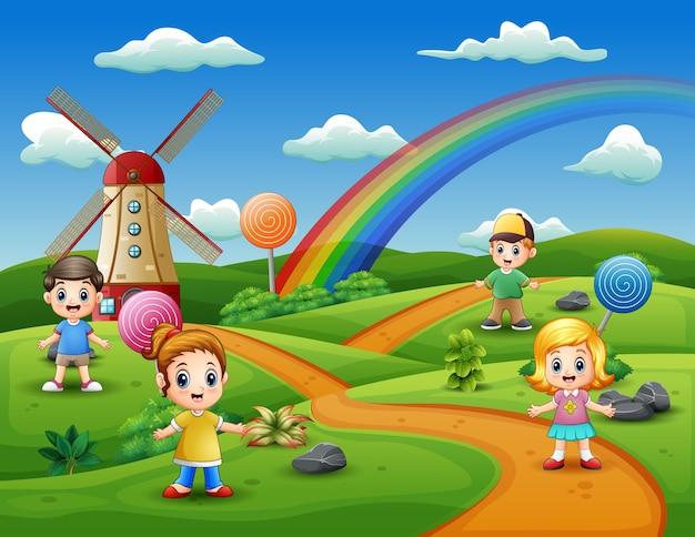 Enfants de dessin animé dans un fond de terre de bonbons