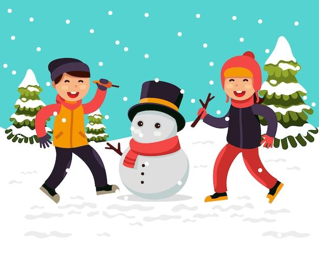 Enfants faisant un bonhomme de neige