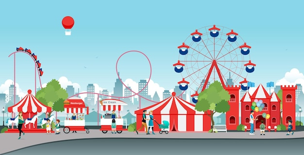 Les enfants et les familles s'amusent dans le parc d'attractions