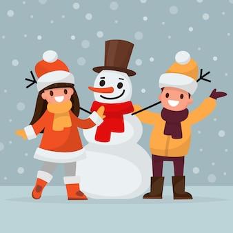 Les enfants font un bonhomme de neige.