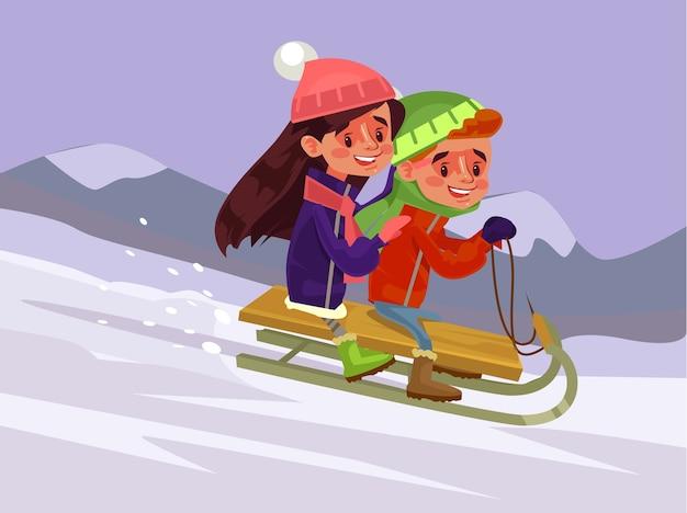 Les enfants glissent l'hiver.