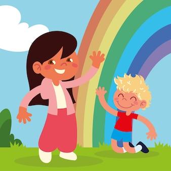 Enfants heureux avec arc-en-ciel