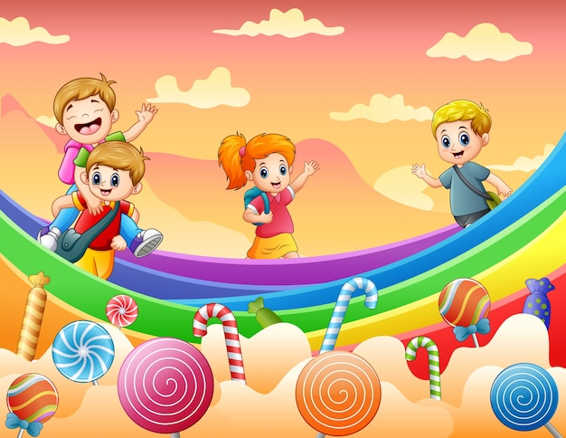 Enfants heureux jouant sur une illustration de la terre de bonbons